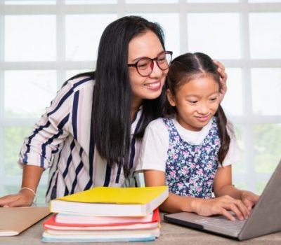 girl studying computer with teacher